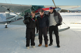 xCREW The Winter Bird Photographer Kevin Ely Arctic Air Alaska pilot Sandy Hamilton and Producer Michael Harris in front of Piper Supercub fitted with skis2 photo Ken Whitten